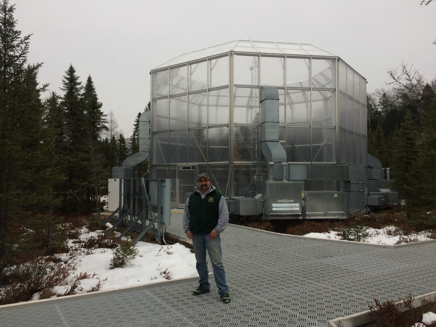 Randy Kolka in front of one of the SPRUCE (Spruce and Peatland Reponses under Changing Environments) experimental chambers at the Marcell Experimental Forest in northern Minnesota.