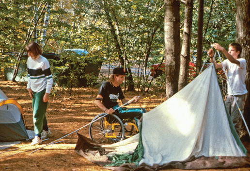 A family setting up camp and a tent
