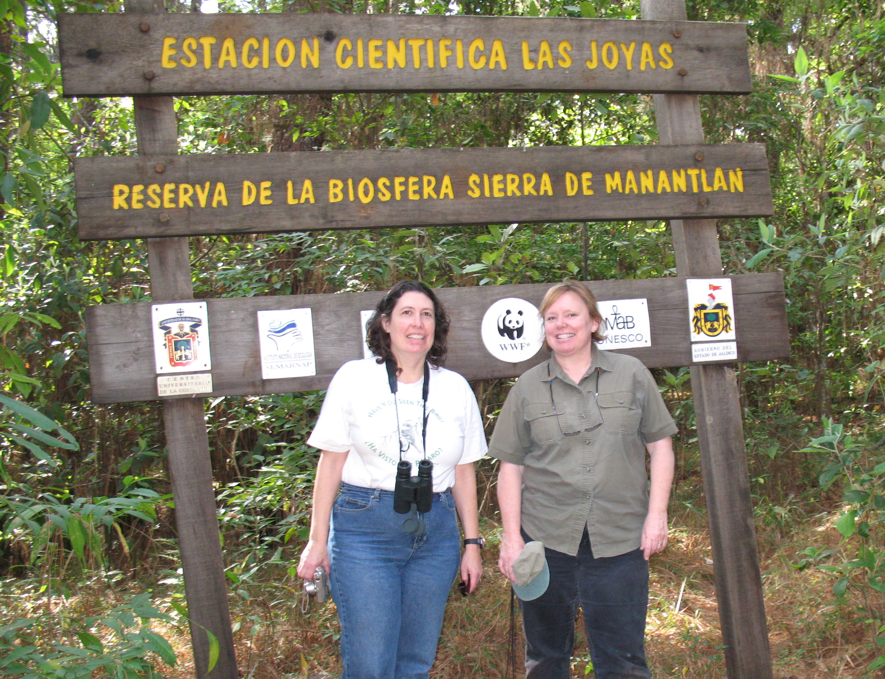Photo: Two women in front of sign for Las Joyas Research Station.
