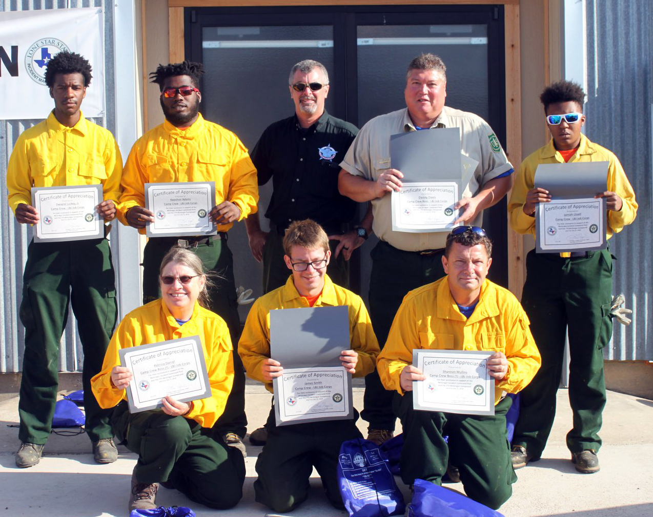 Photo: Job Corps students hold up certificates.