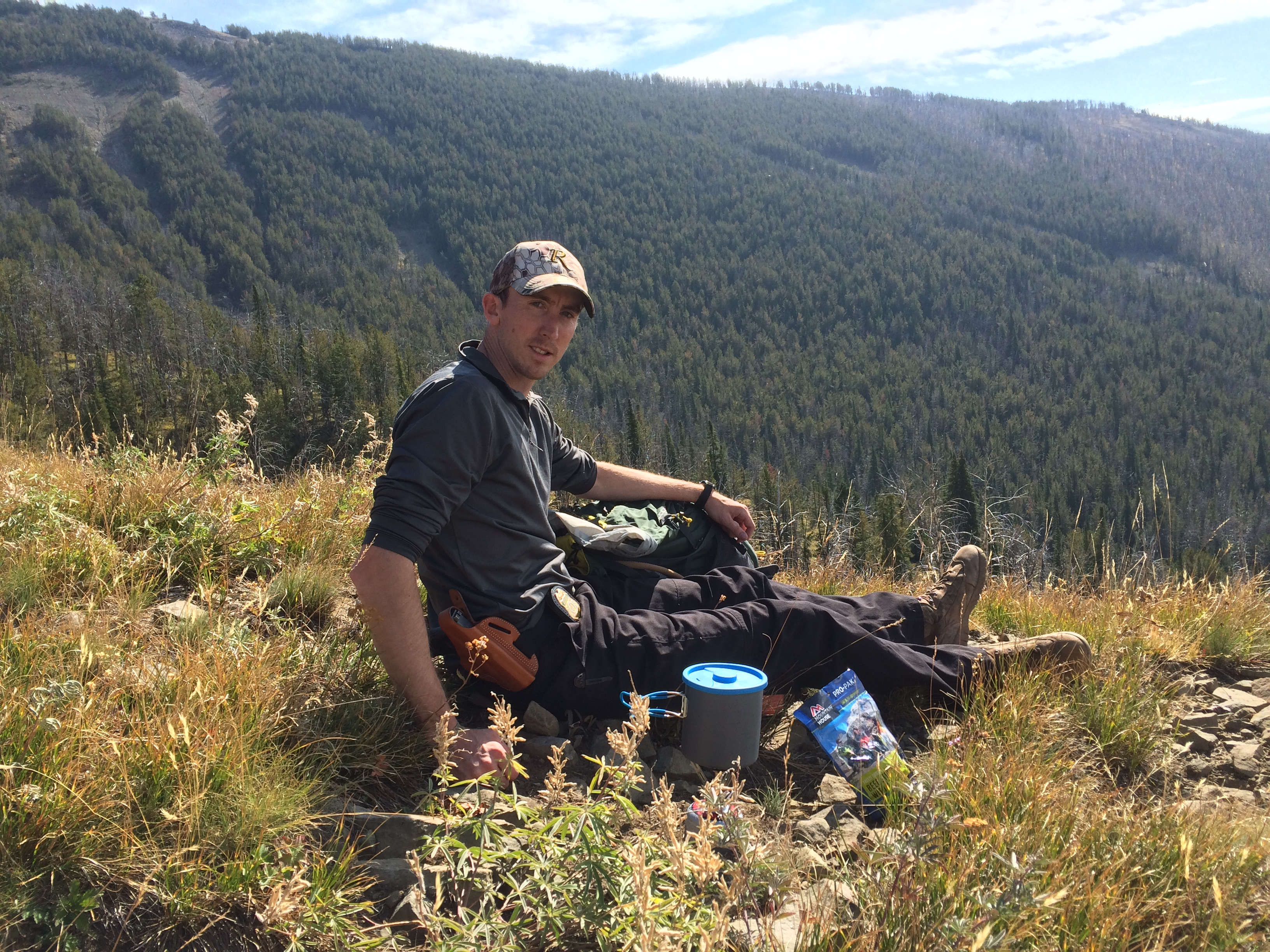 Linhart assisting with a reconnaissance mission to observe off-highway vehicle use in the mountains on the Custer Gallatin National Forest. (Photo Credit: USDA Forest Service.)