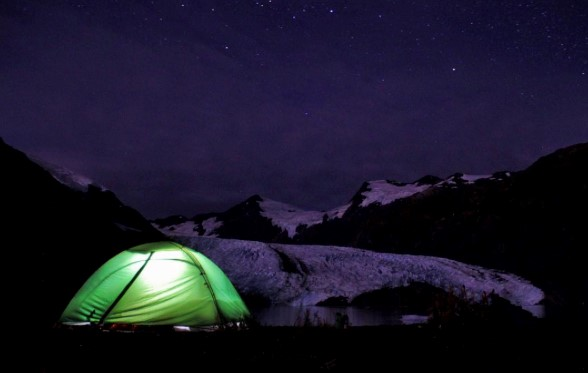 A photo of a lit up tent at night