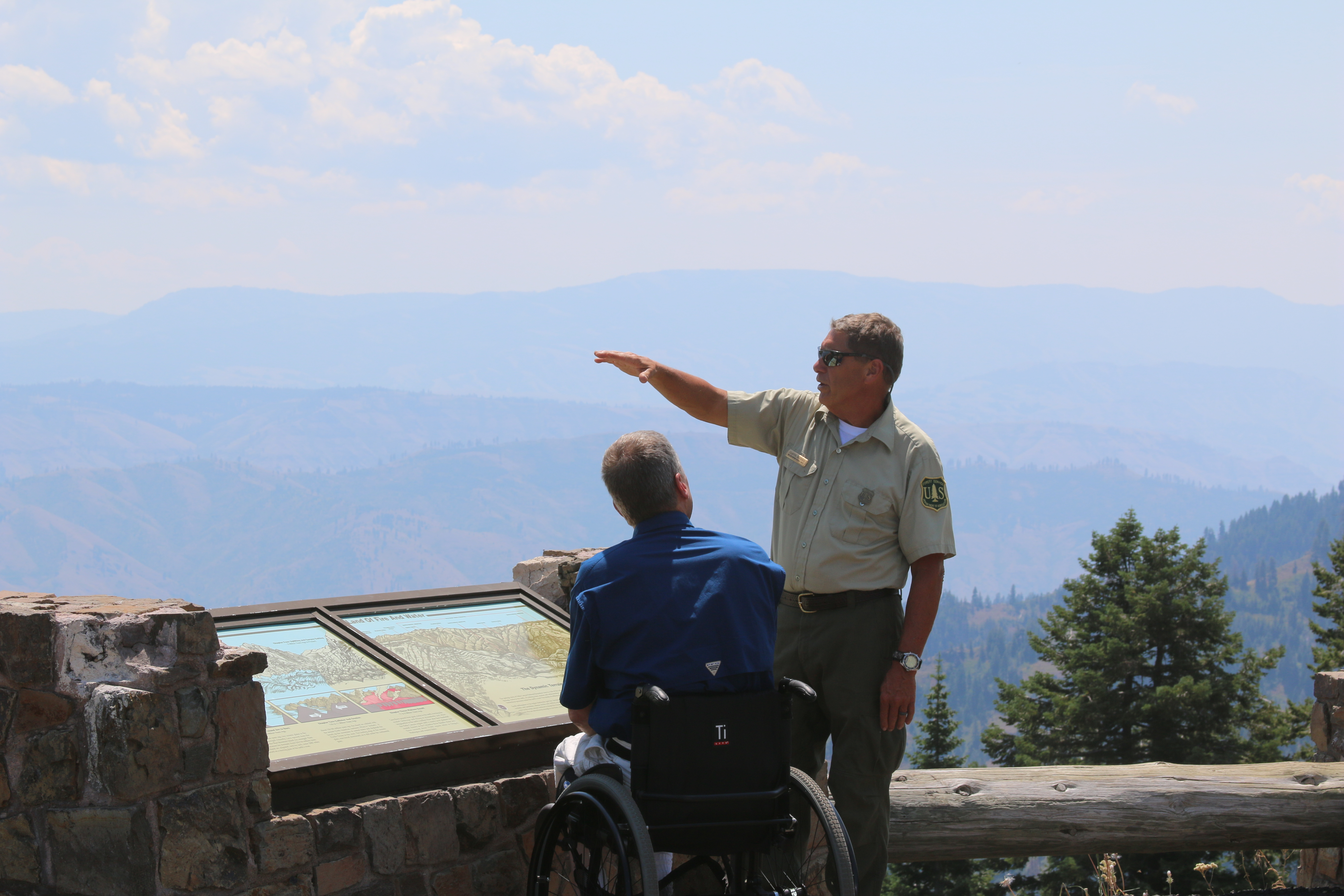Forest Service employee discussing the forest with public