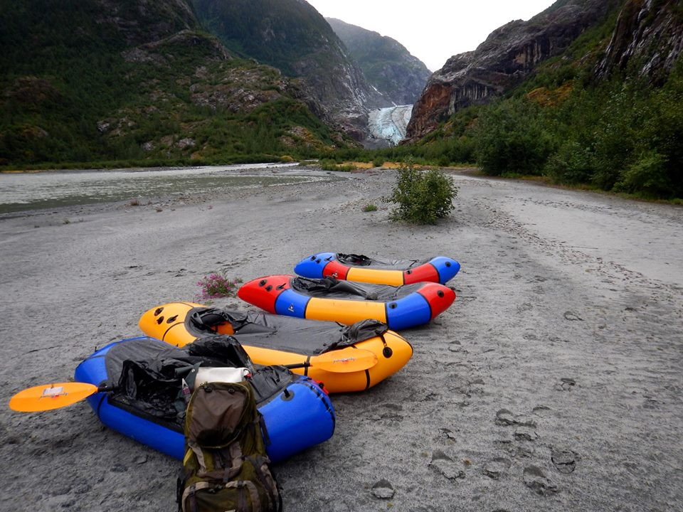Photo: row of inflatable pack rafts.