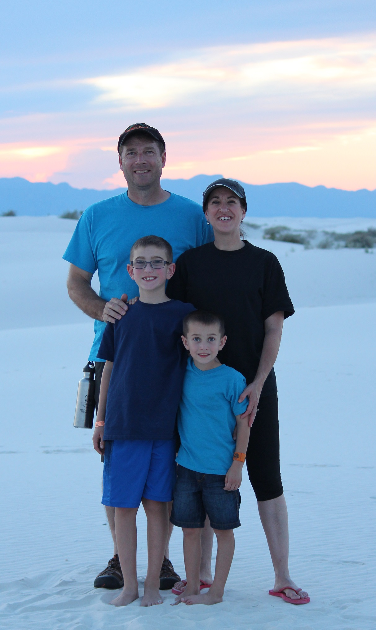 John with his wife, Caroline, and their children at White Sands, New Mexico