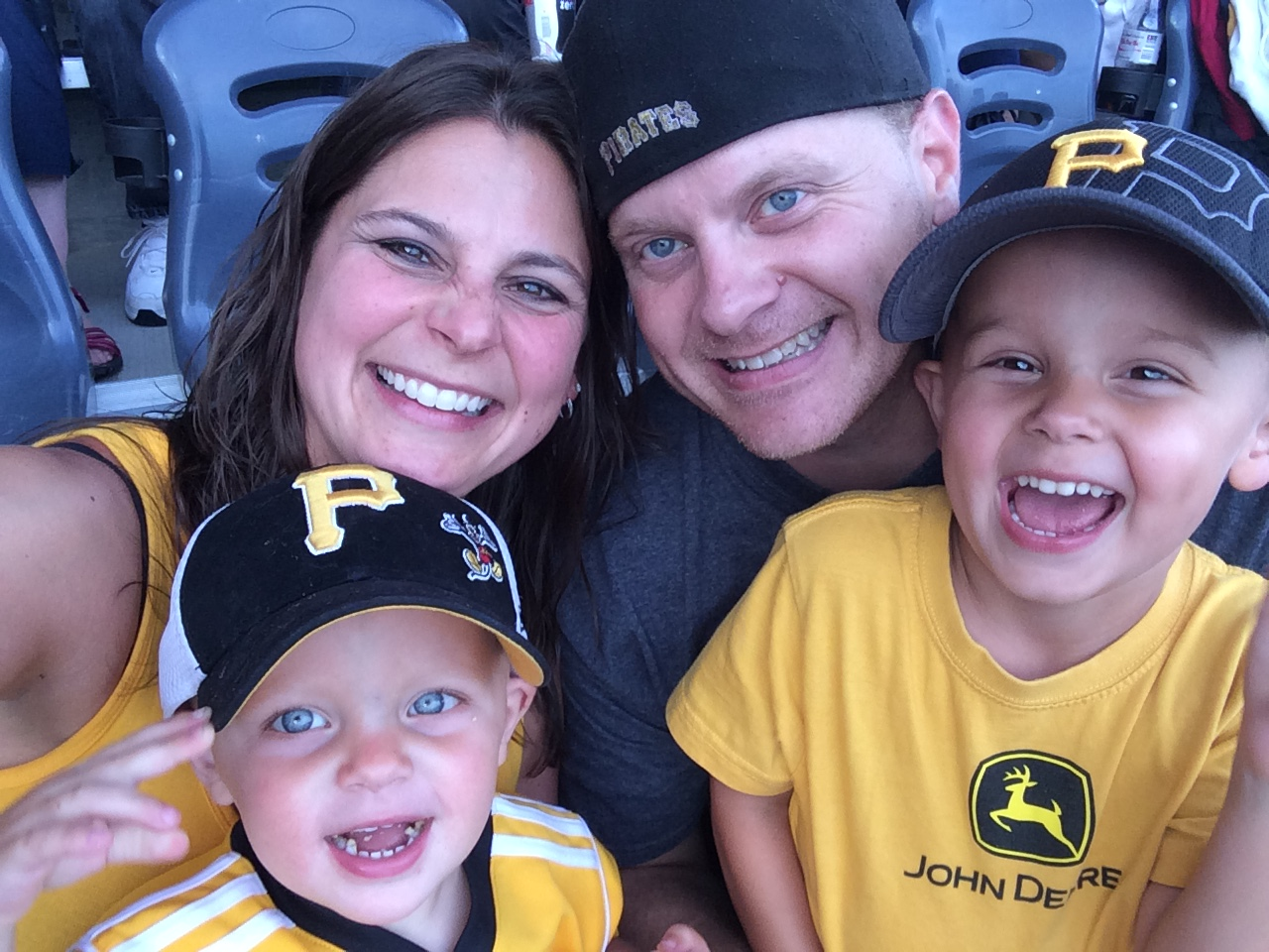 A photo of the Skowronski family, Susie, Will, Charlie and Nick at a Pirates baseball game