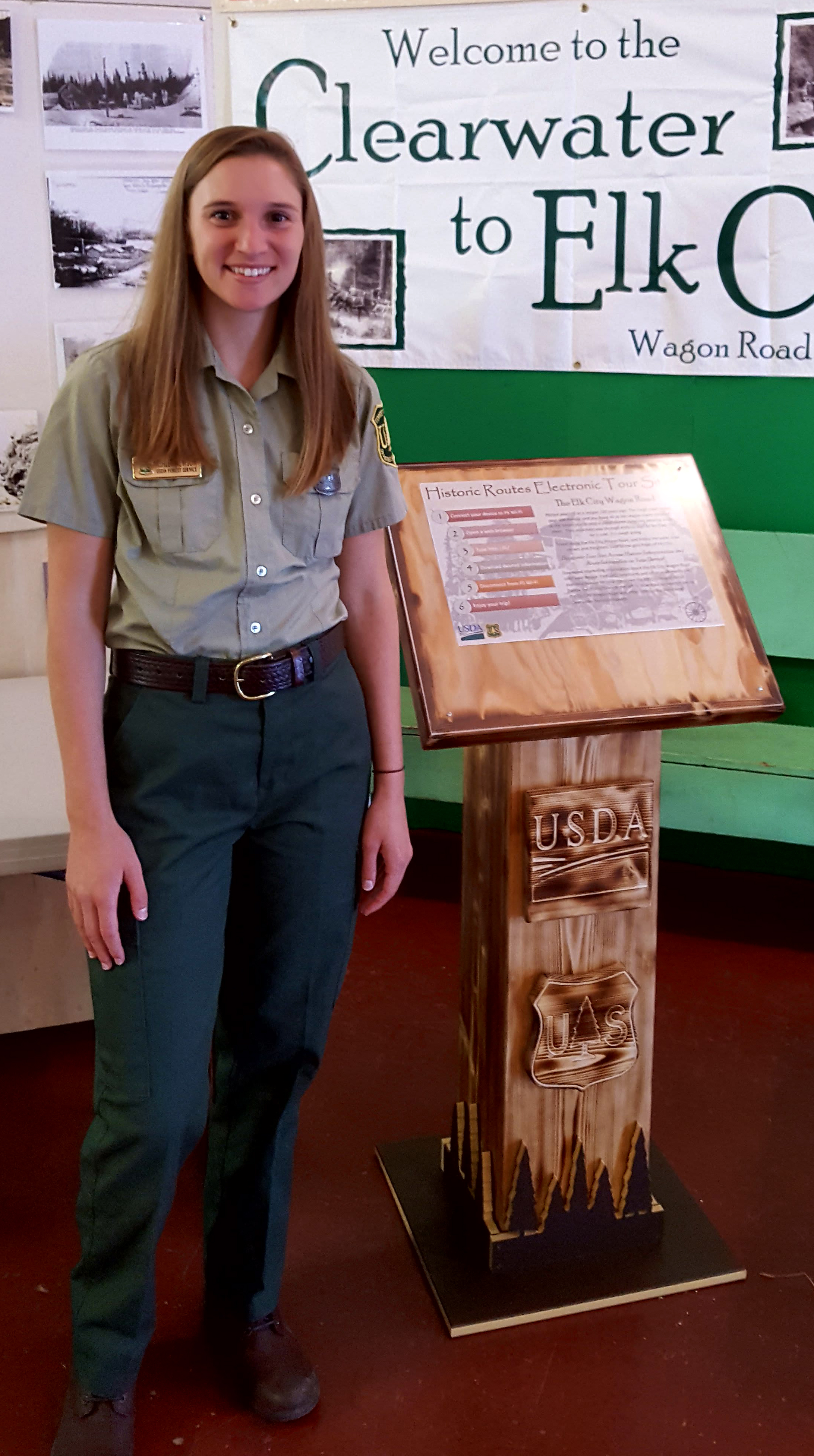 Photo: Newson stands beside FOrest Service display.