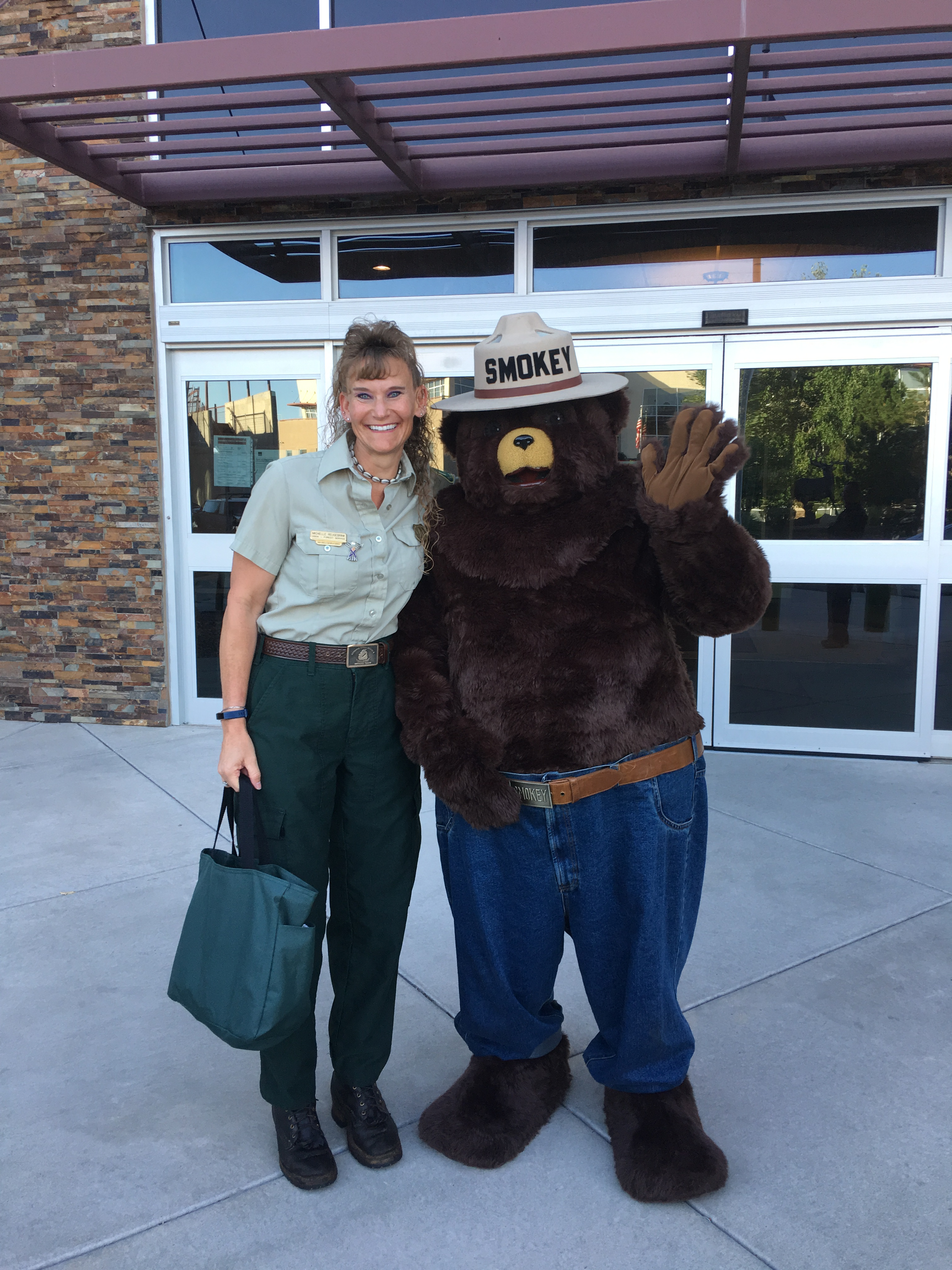 A picture of Michelle Reugebrink with Smokey Bear