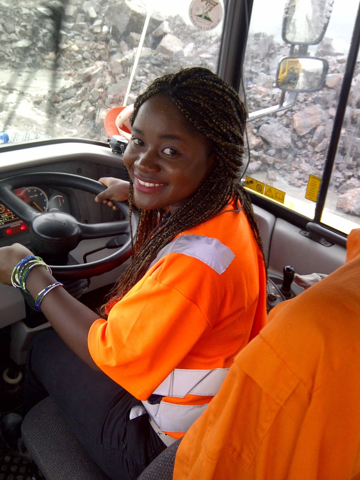 Ruby behind the wheel of a giant mining vehicle. (Photo Credit: Ruby B. Johnson.)