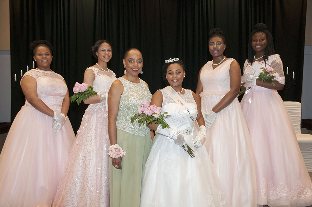 A photo of Sharon Parker with 2017 debutante Cotillion queen and court