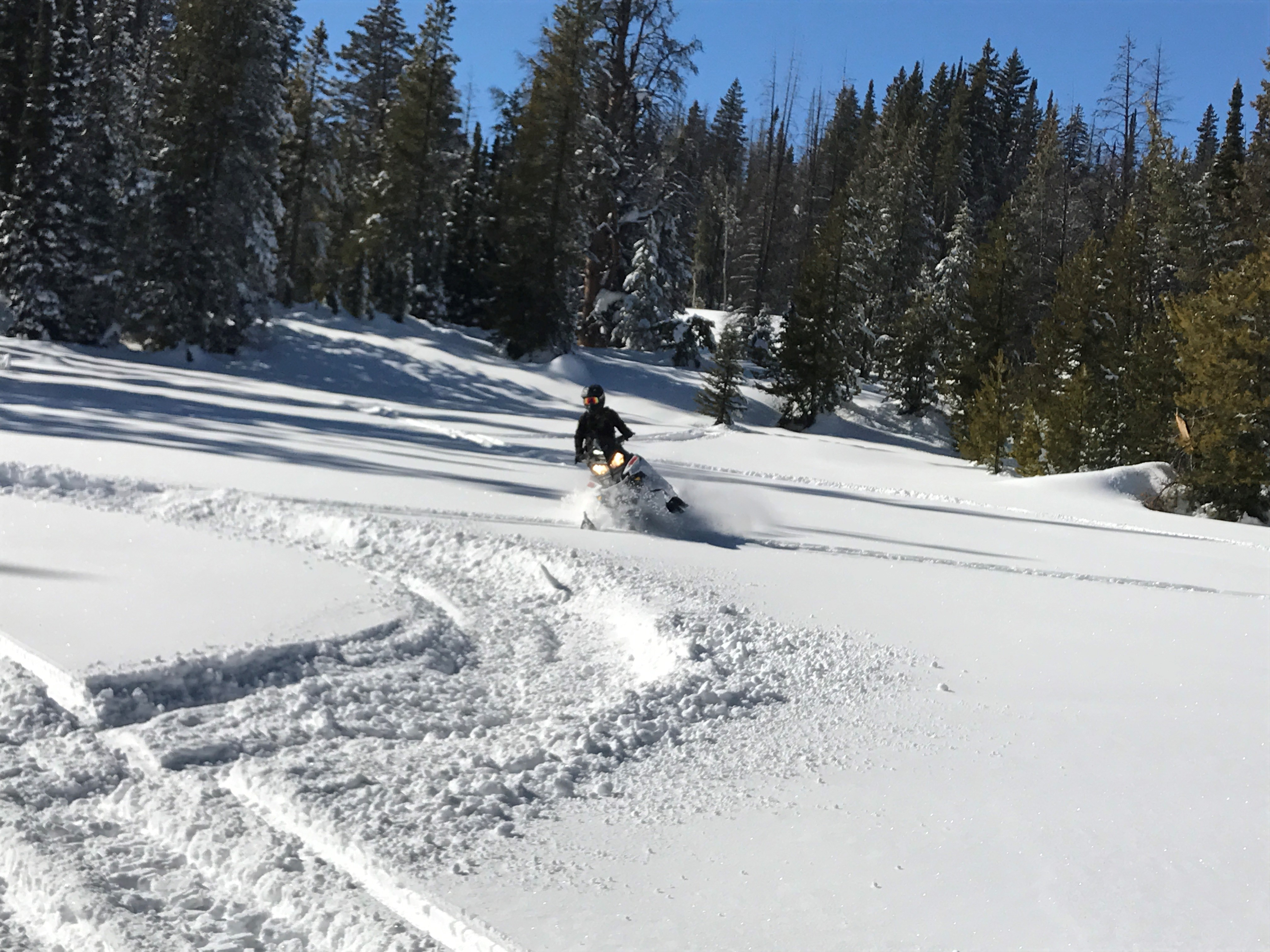 Hannah Nadeau on a snowmobile in the Sierra Madre mountains.