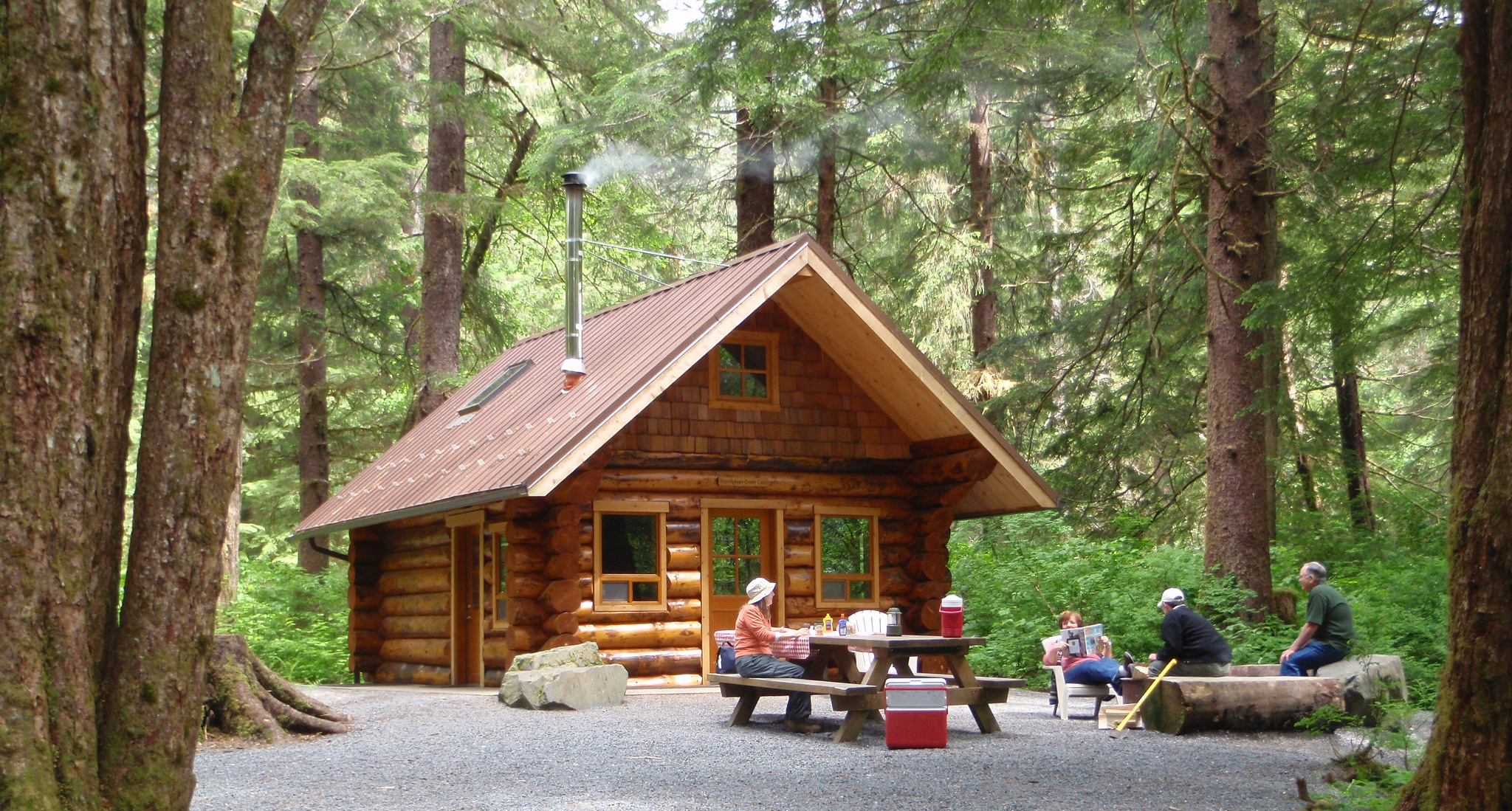A photo of a family in a campground with a cabin in the background