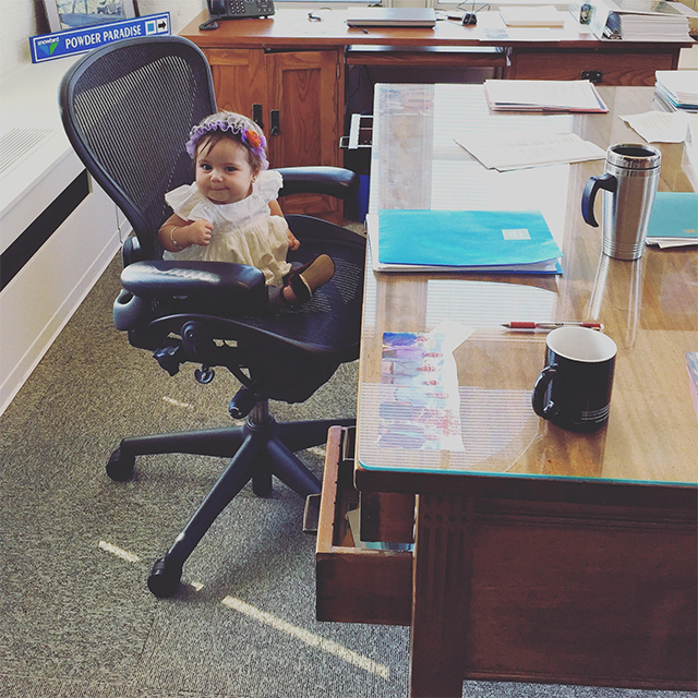 A photo of Helen Cortes' daughter, Stella Luna, visiting U.S. Forest Service Chief Tidwell and siting on his chair