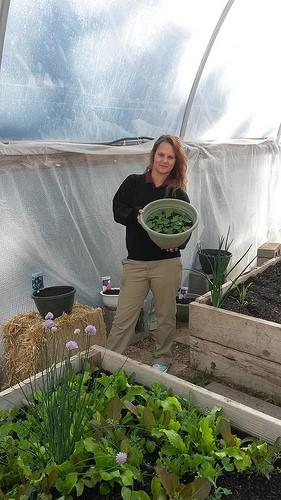 A photo of Boxelder student Celina Wagner shows off the vegetables and flowers