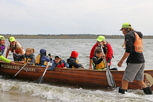 A photo of students got the canoe experience without even leaving the shoreline thanks to the creativity of the Wilderness Inquiry crew