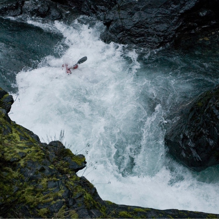 A photo of a white water rafter in a river