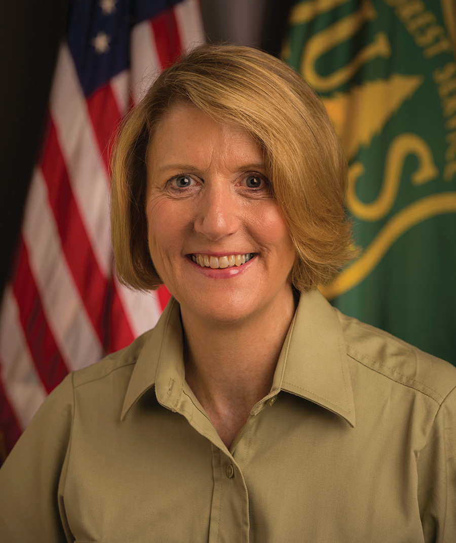 A picture of Vicki Christiansen in Forest Service uniform.
