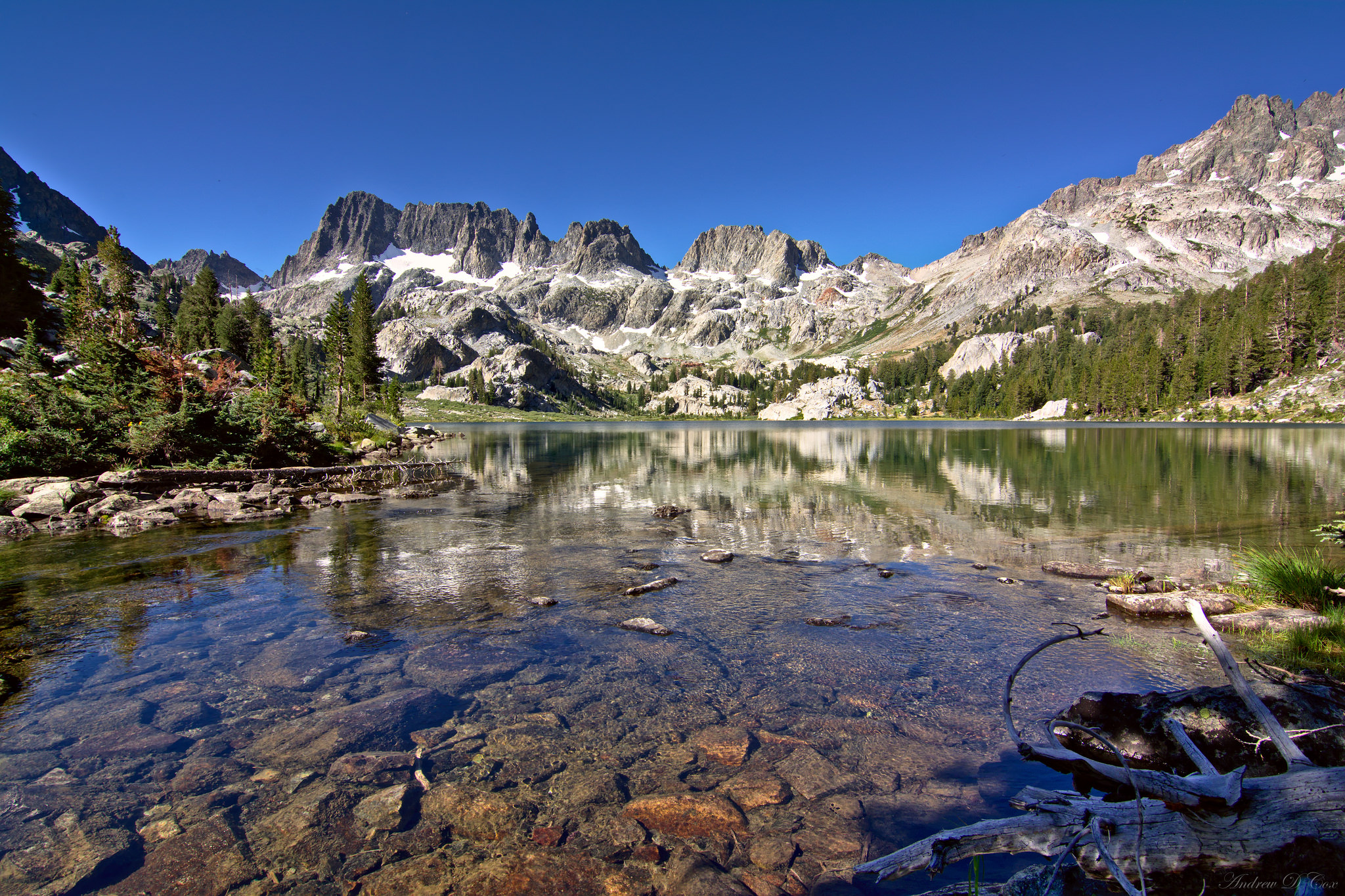 A picture of a beautiful lake below the Minarets (mountains) in the Ansel Adam Wilderness Inyo National Forest, California.
