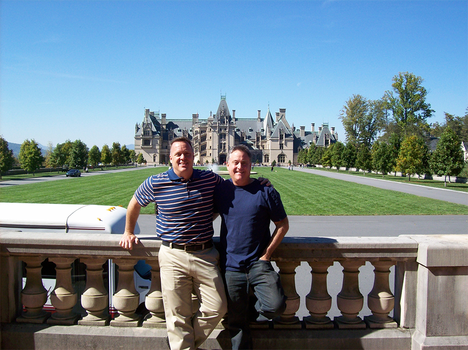 A photo of Robert Westover with his husband, Tom Fulton, at the Biltmore estate in Asheville, NC.