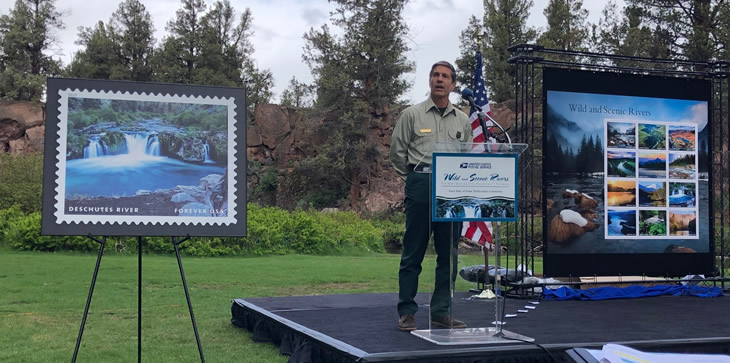 A picture of Pacific Northwest Regional Forester Glen Casamassa speaking at the announcement event for the Wild and Scenic River stamp series in Bend, Oregon, May 21, 2019.
