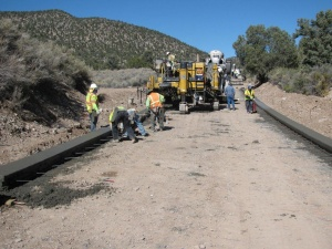 Work at Lovell Canyon on the Humboldt-Toiyabe National Forest in 2012 involved construction of 11 low-water fords on the Lovell Canyon Road.  Construction workers are using a special machine to form the edges of one of the fords. (U.S. Forest Service)
