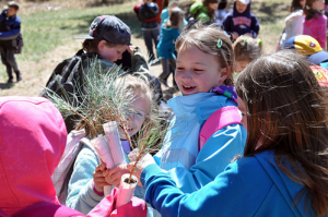 Students from Discovery Campus Elementary School compare trees during the kids4Trees Event on the Pike National Forest in Colorado.  More than 1,200 students, teachers and Scouts planted 4,500 trees at the Monument Fire Center on the forest. (U.S. Forest