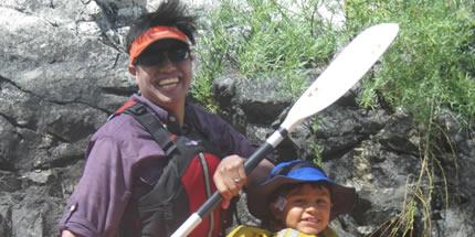 A picture of Irvin Fernandez rafting with his son, Ethan, on the Rogue River, Rog