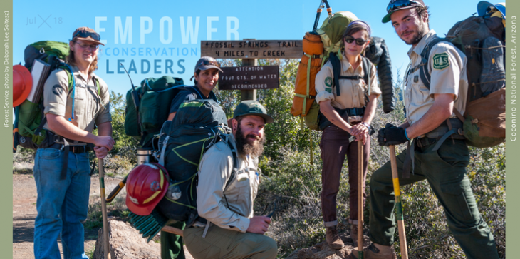 "A picture of five Forest Service employees standing in front of a trailhead.  The text over the picture reads, ""Empower Conservation Leaders"""