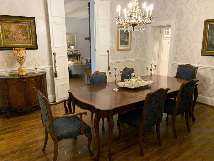 A picture of a dining room table and chairs are from the mid-1800s.