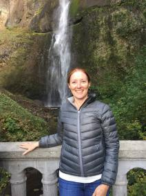 Laurie exploring Multnomah Falls at the Columbia River Gorge National Scenic Area managed by the USDA Forest Service. Schoonhoven family photo.