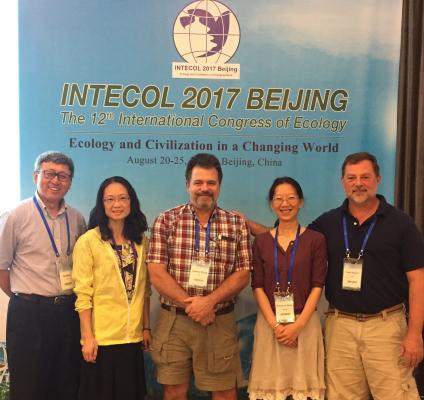 A picture of Ge Sun, far left, with four other colleagues that helped organized the 2017 Intecol Conference in Bejing, China.