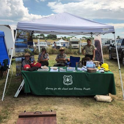 USDA Forest Service and National Park Service booth at the Oglala Lakota Nation Wacipi Rodeo Fair in Pine Ridge, South Dakota. USDA Forest Service photo.