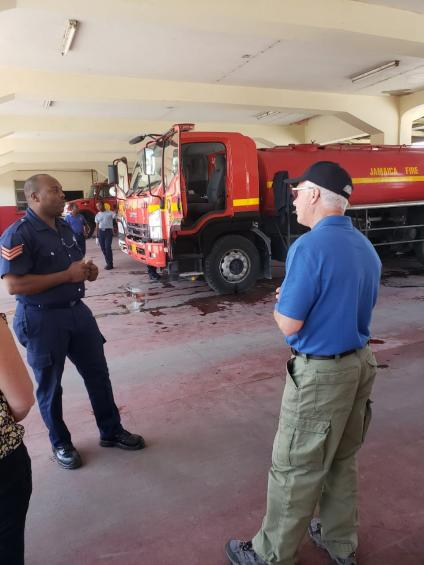 Two men talking at a Jamaican Fire Brigade facility