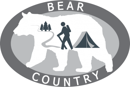 A graphic of Bear Country, showing a large outline of a bear and a hiker, tent and trees inside the bear outline.