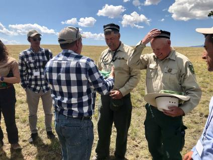 Forest Service employees exchanging hats with Uzbekistan reps