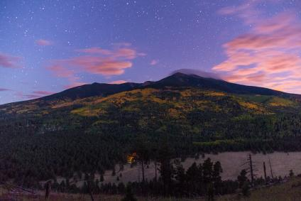The stars come out as the sun sets on fall color on the San Francisco Peaks, Coconino National Forest, Arizona viewed from the White Horse Hills along Forest Road 418, October 1, 2016. (Forest Service photo by Deborah Lee Soltesz)