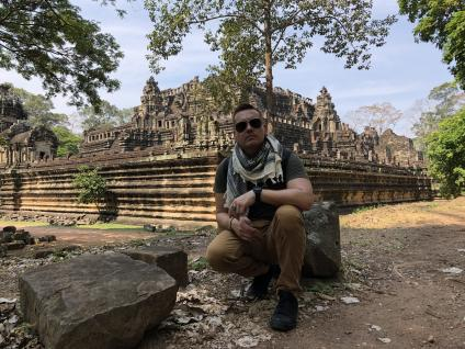 In his free time, Raymond enjoys traveling around the world visiting interesting archaeological locations and ancient cities like this one in Cambodia.