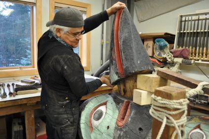 A picture of a Tlingit master carver that begins restoration of the Yaxté Totem which overlooks Auke Village Recreation Area within the Tongass National Forest.