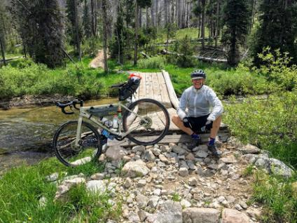 Visitor Map fan Bob Huber pauses for a photo during his recent bicycle trip tour of national forests in Idaho.