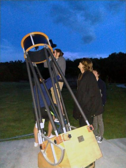 Students aligning a telescope