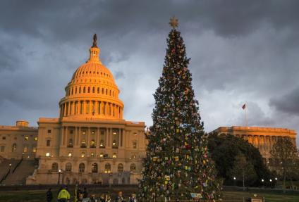The U.S. Army Brass Quintet performs in front of the adorned U.S. Capitol Christmas Tree.