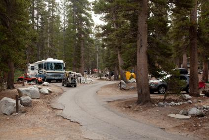 A picture of a developed campground site with several recreational vehicles seen parked at campsites.