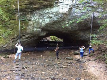 A picture of graduate students and researchers setting up mist nets to capture bats at Rock Bridge Memorial State Park, near Columbia, Missouri.