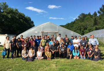 A picture of the 2019 Intertribal Nursery Council Meeting tour stop at the Eastern Shawnee Tribe of Oklahoma's greenhouses.