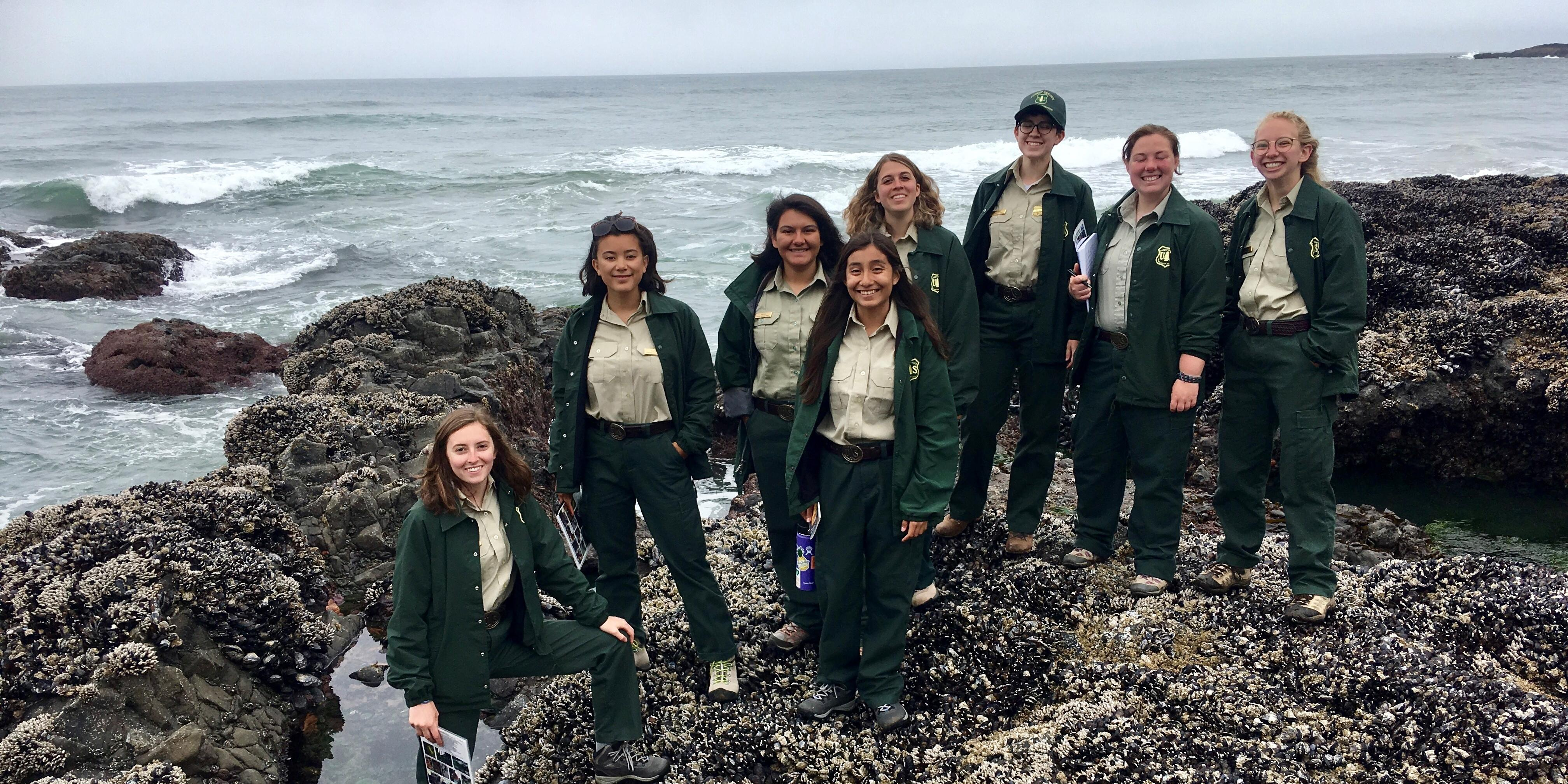 A picture of eight Forest Service employees that are women.