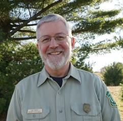 Portrait photo of Phil Huber in Forest Service uniform