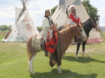 A photo of Members of Ute Tribe wear traditional dress