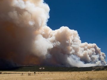 A photo of a big smoke column from Arizona's Wallow Fire in June 2011.