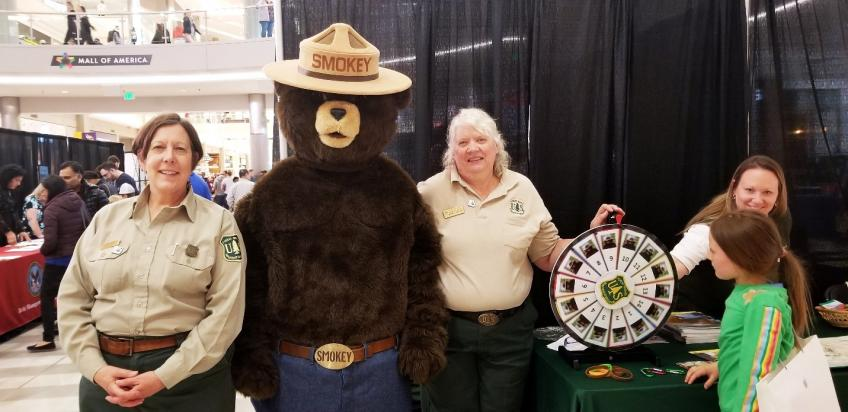 FS employees pose with Smokey at Mall of America event