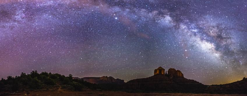 A picture, taken at night, showing a view of the Milky Way over Cathedral Rock, seen from the Cathedral Rock Trailhead on Back O' Beyond Road, Coconino National Forest, Sedona, Arizona.